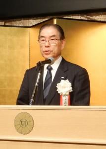 挨拶する印刷工業会の山田会長