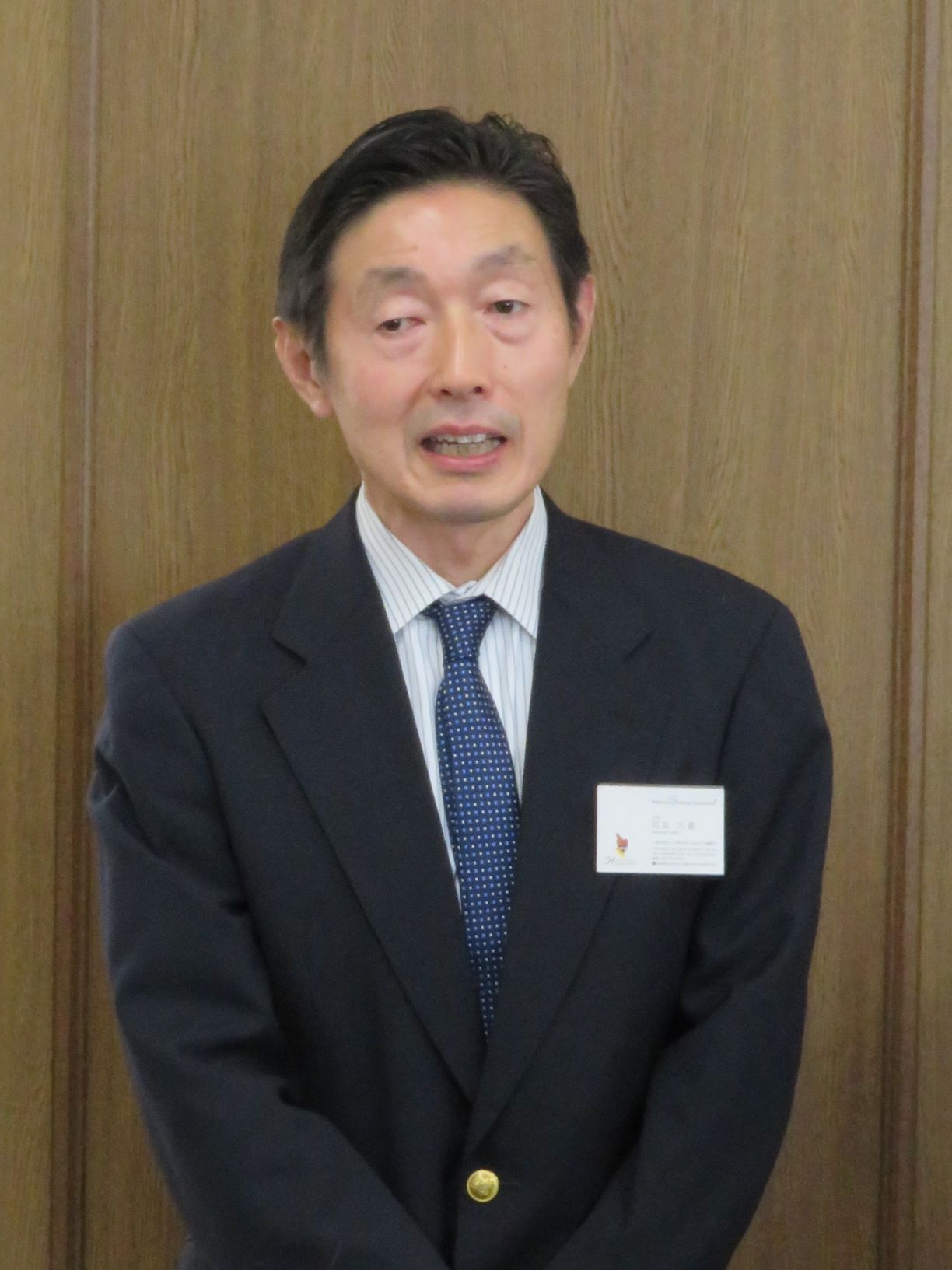 挨拶する日本WPA田畠会長