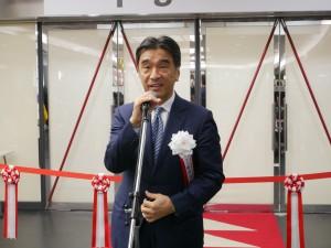 挨拶するJAGATの塚田会長