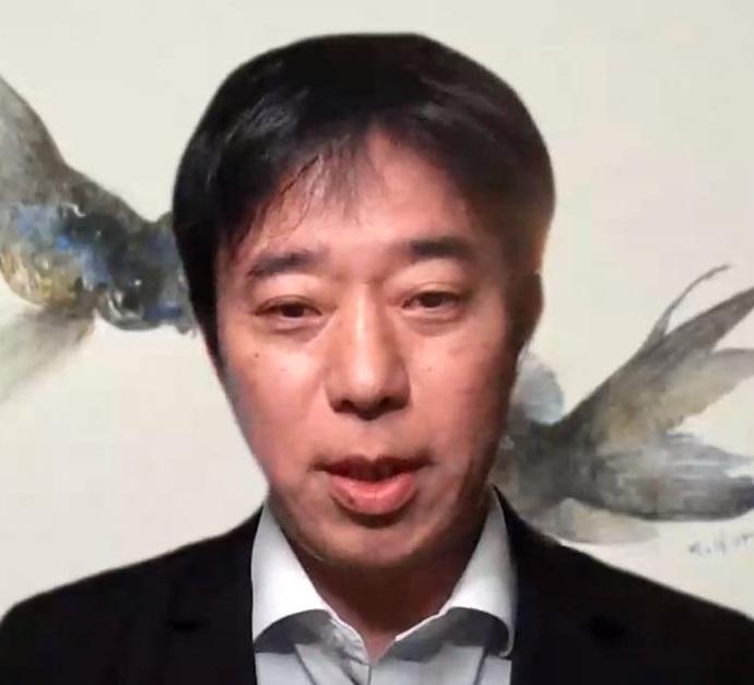 講演する佐藤氏